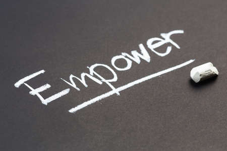 black empowerment: Empower word topic on chalkboard Stock Photo