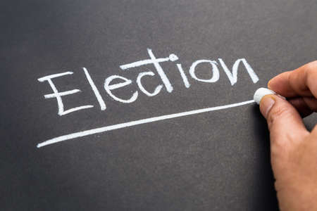 topic: Hand writing Election word topic on chalkboard Stock Photo