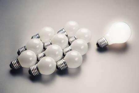 follower: Glowing light bulb as leader with many small bulbs as follower