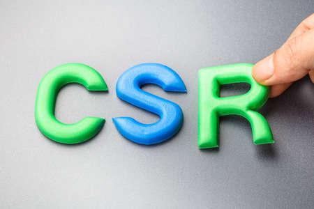 abbreviation: Hand arrange alphabet letters as CSR, abbreviation of Corporate social responsibility Stock Photo