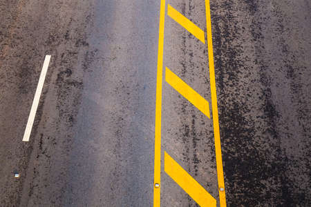 lane lines: Asphalt road lane with traffic lines, almost dry after the rain, top view