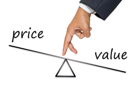 value add: Businessmans hand as finger walking on balance measurement to reduce price and add value