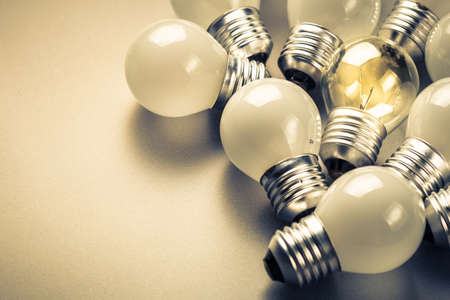 Small light bulbs and the different one glowing in the group, small business, original idea concept