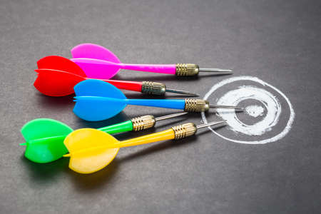 multiple targets: Many darts aim on chalk drawing target, goal setting, competition or trend concept