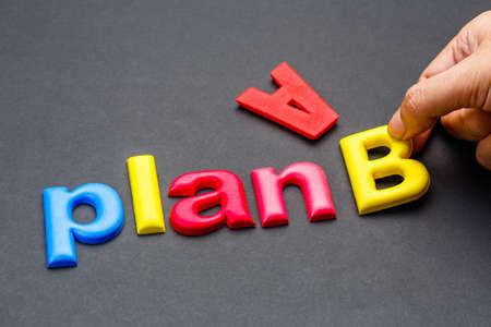 Hand arrange alphabet letters as Plan B