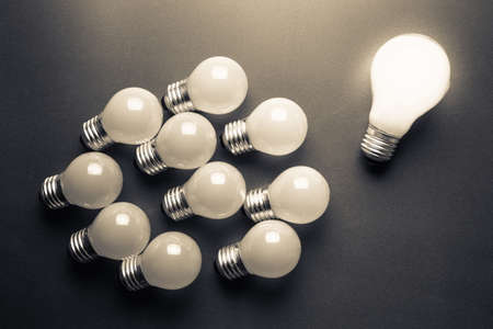 follower: Bigger light bulb glowing with many smaller light bulbs