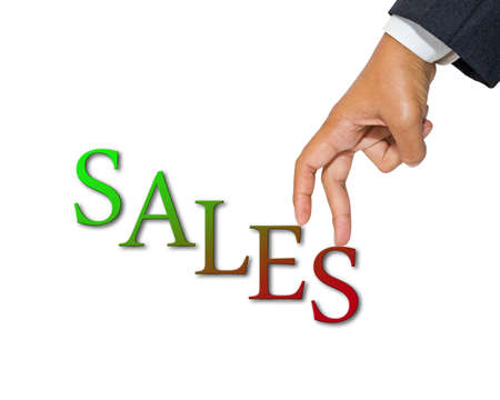 Businessmans hand as finger walking up on Sales word, increase sales concept Stock Photo