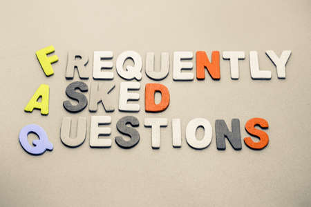 asked: Frequently Asked Questions text arranged by wood letters