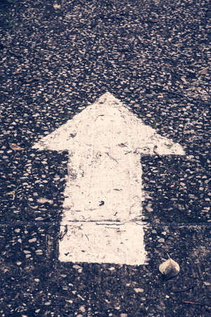 one lane road sign: Vintage photo of arrow sign on old road