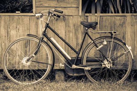 original bike: Vintage bicycle on wood wall
