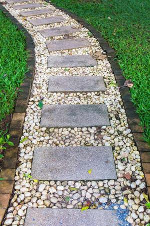 Brick and pebbles walkway in the garden