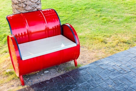 window bench: Red bench in the park, adapted from gasoline tank and wood window Stock Photo