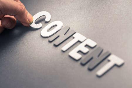 dea: Closeup hand arrange wood letters as Content word