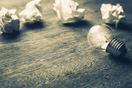 differentiation: Small light bulb with crumpled ball paper Stock Photo