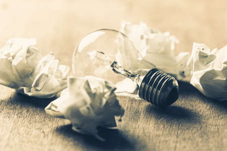 differentiation: Usable Idea, closeup light bulb in the group of crumpled ball paper