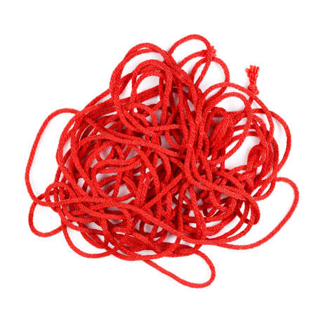 Pile of single red rope isolated on white background