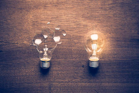 Broken and Glowing light bulb comparison concept, problem and solution, failure and success, learning from mistake