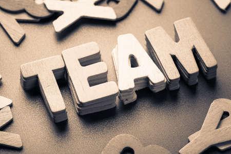 Stack wood letters of TEAM word, team building concept Reklamní fotografie