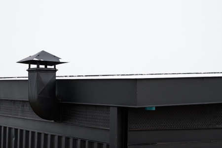 Abstract roof top of metal building with metal chimney on white sky Stock Photo