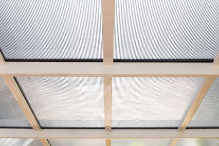 Polycarbonate awning roof on metal beam structure Standard-Bild