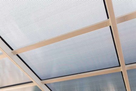 Polycarbonate awning roof on metal beam structure Stock fotó