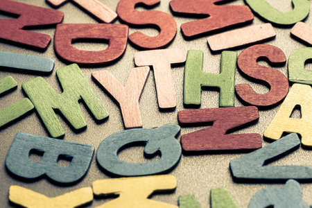 Closeup MYTHS word in scattered wood letters