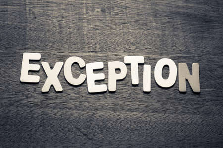 Exception word  by wood letters on wood background