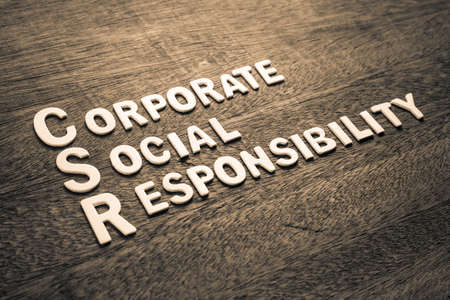 CSR abbreviation with text Corporate Social Responsibility by wood letters on wood background