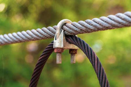 Closeup steel rope clip of sling bridge Stock Photo