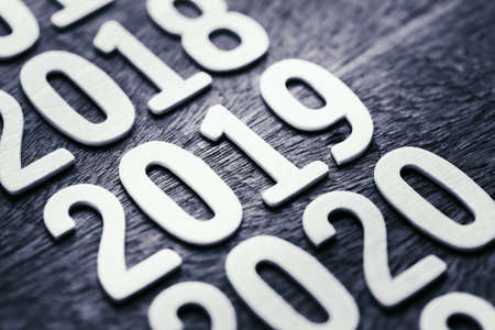 2019 in running year numbers on wood background, shallow depth of field 写真素材