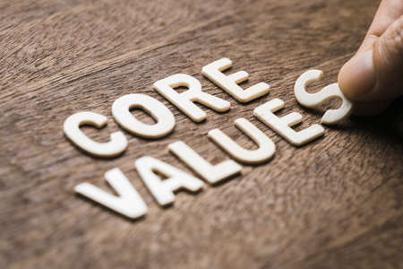 Closeup hand arrange wood letters as CORE VALUES word Archivio Fotografico