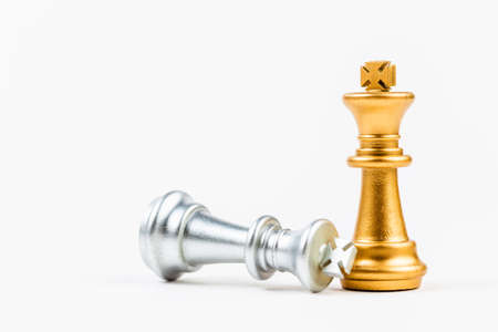 Golden chess standing and the silver one is down on white background, success leader or other comparison leader concept
