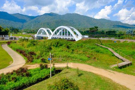 White railway bridge built during World War 2 named Thachomphu Bridge in countryside of Mae Tha district. Imagens