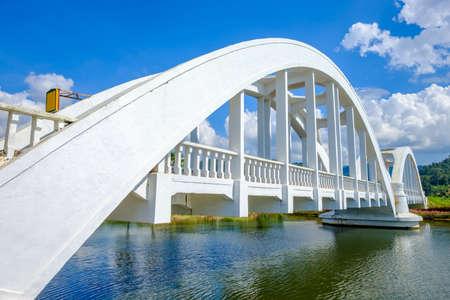 White railway bridge built during World War 2 named Thachomphu Bridge over the Mae Tha river.