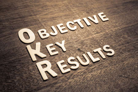 Objective Key Results (OKR) wood letters arraanged on wood