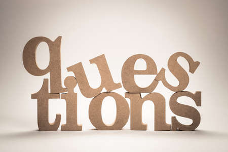 QUESTIONS topic arranged by wood letters on white