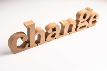 Change word by wood letters arranged on white
