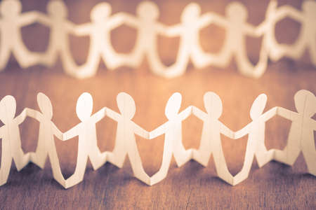 Many paper human dolls as crowded people or community concept Stock Photo