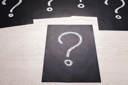 Question Mark drawing with chalk on black paper