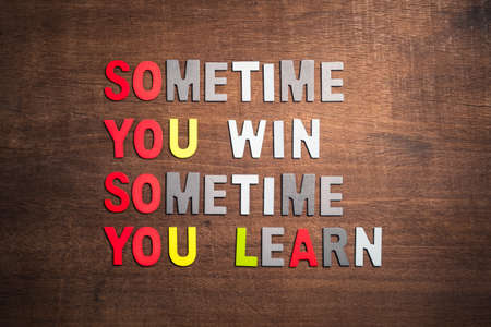 Motivation quotation (Sometimes You Win, Sometimes You Learn) arranged by wood letters on wood background Stok Fotoğraf
