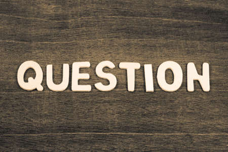 QUESTION word by wood letters arranged on wood background Standard-Bild - 123952511