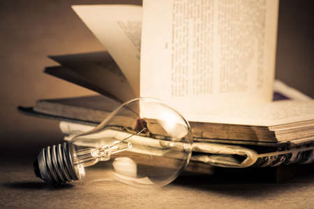 Light bulb with pile of old book for reading or knowledge concept Standard-Bild - 123952512