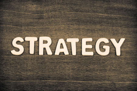 STRATEGY word by wood letters arranged on wood background Standard-Bild - 123952523