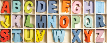 Color English wood letters in partition box, toy or equipment for education, learning English language