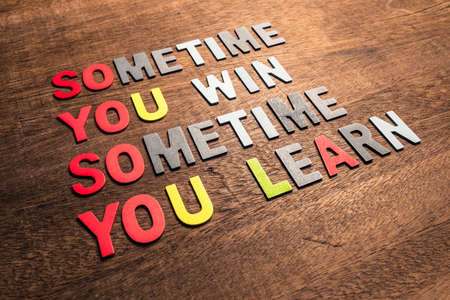 Motivation quotation (Sometimes You Win, Sometimes You Learn) arranged by wood letters on wood background Standard-Bild - 123952554