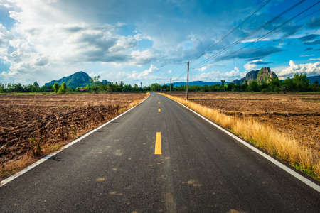 Asphalt road in the agricultural plough land, countryside of Thailand Standard-Bild - 124679795