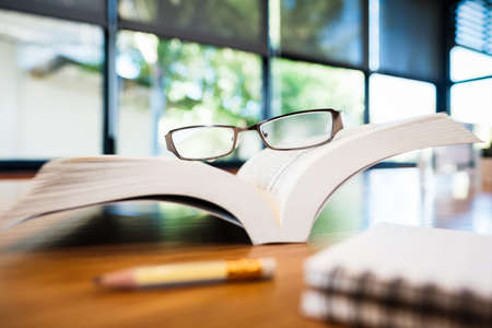 Eyeglasses on the opened pocket book with part of notebook and pencil for take a note Stok Fotoğraf