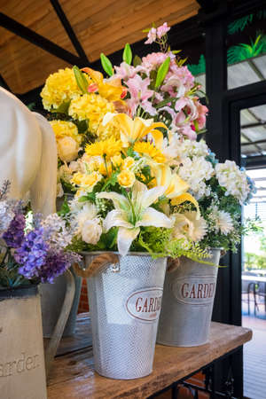 Bunch of artificial flowers decorated in the cafe