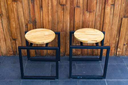 Designed wooden and metal chairs, outdoor seats of coffee shop