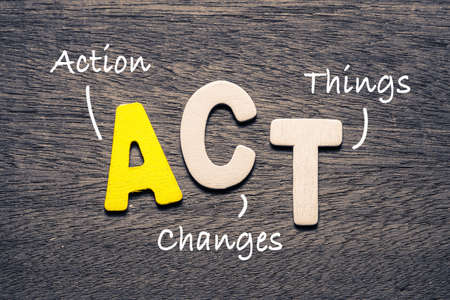 ACT wooden alphabets on wood background with text acronym (Action Changes Things) Archivio Fotografico